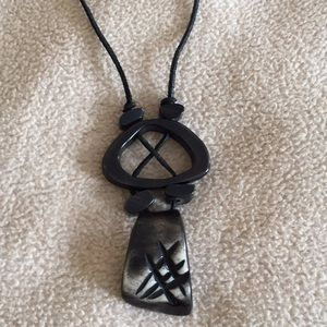 Jewelry - Pendant on leather string.